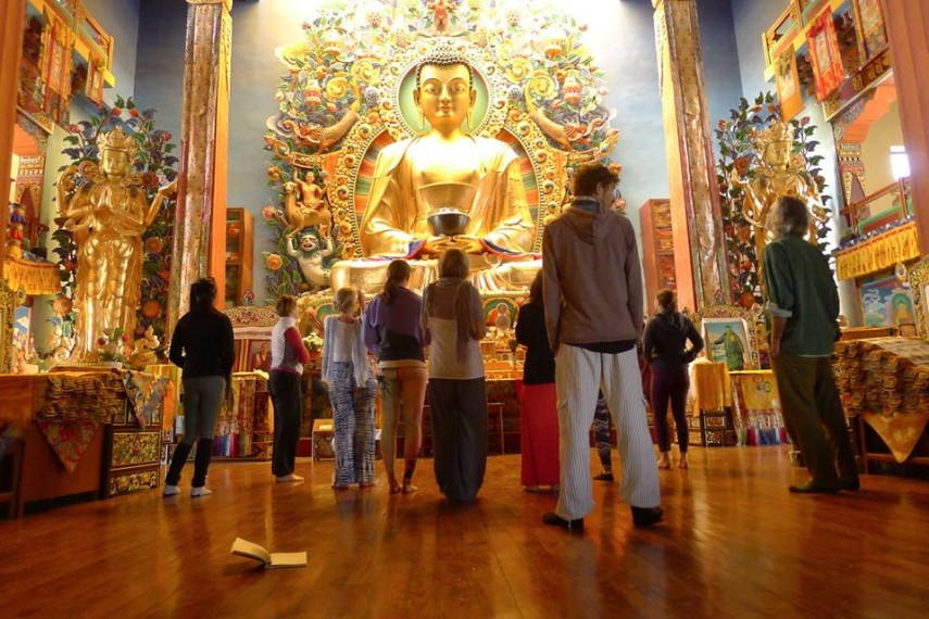 Buddha statue at monastery hosting yoga retreat in Nepal