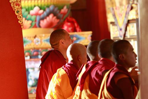 Our hosts in prayer during Kundalini meditation retreat nepal